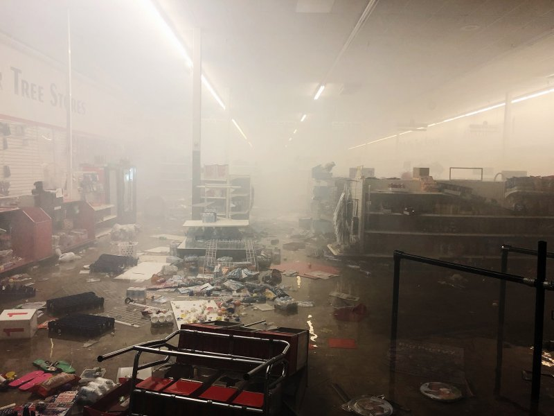 The remains of a Dollar Tree store smolders after protests in Minneapolis on May 28, 2020.
