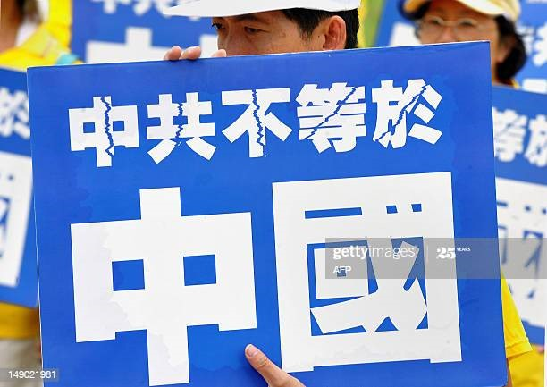 protesters wave sign that says ccp does not represent china